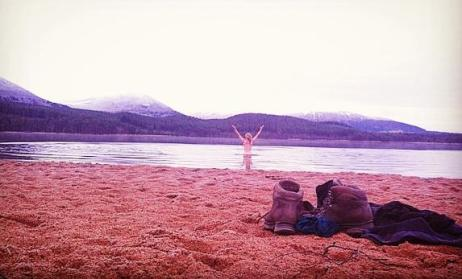 Wild swimming at Loch  Morlich in March meltwaters