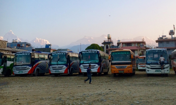 Mountain peaks behind the bus park